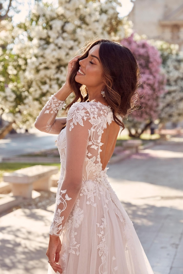 stunning wedding dress with keyhole back and long lace sleeves