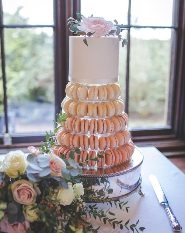 Ombre macaron tower topped with a single layer of cake for cutting by Boutique Bakery in Chester