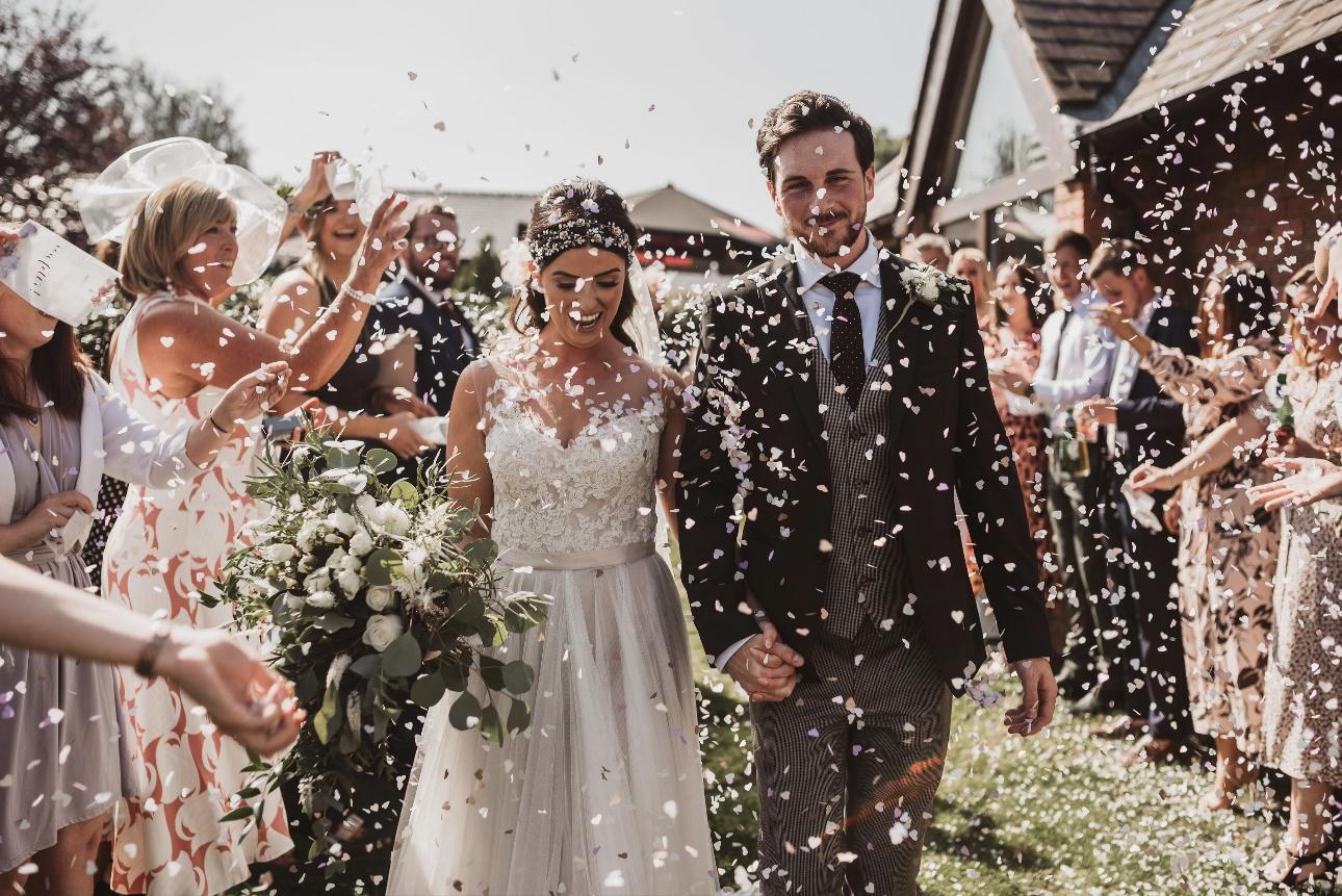Confetti surrounds couple