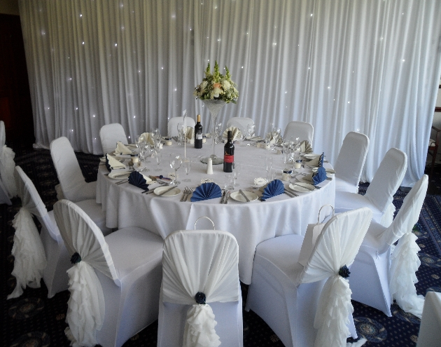 Wedding reception layout at Haydock Park Golf Club with white and navy theme