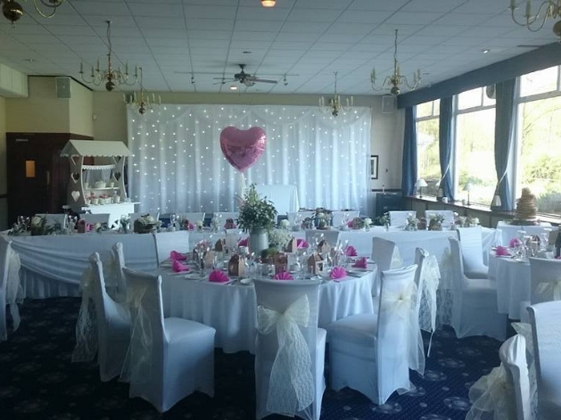 Wedding reception layout at Haydock Park Golf Club with pink theme and sweet cart in the background