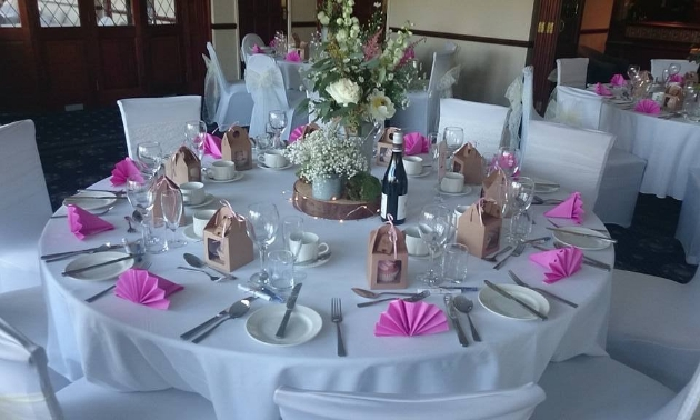 Wedding reception layout at Haydock Park Golf Club with rustic and pink theme