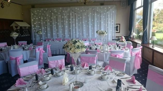 Wedding reception layout at Haydock Park Golf Club with fairylight backdrop
