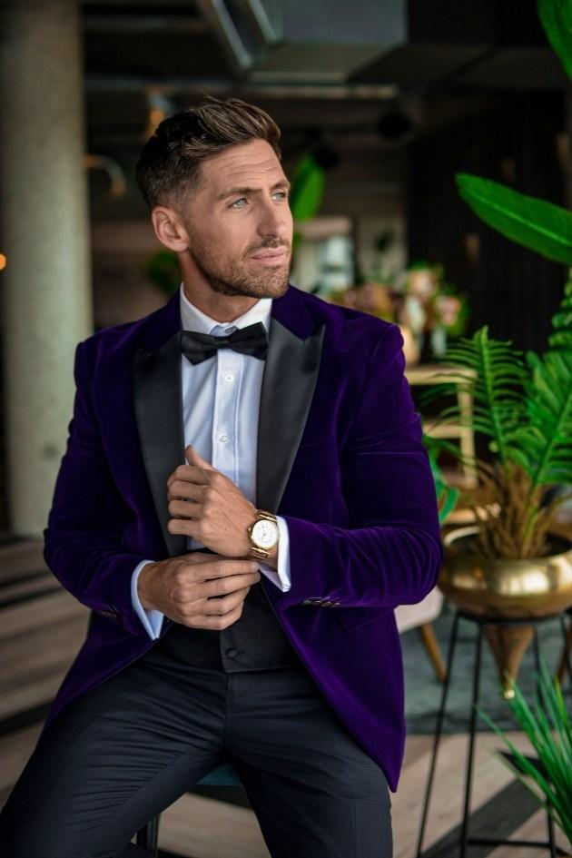 Groom dressed in purple velvet dinner jacket