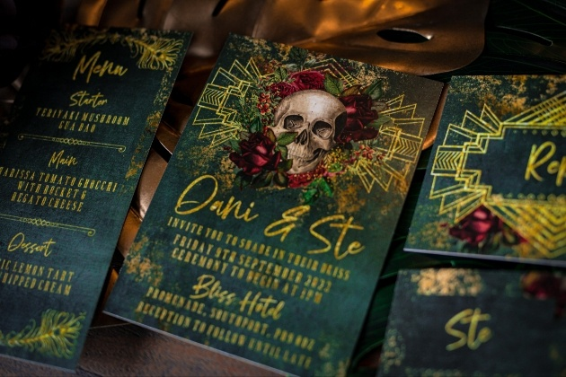 Emerald green and gold wedding stationery with skull motif
