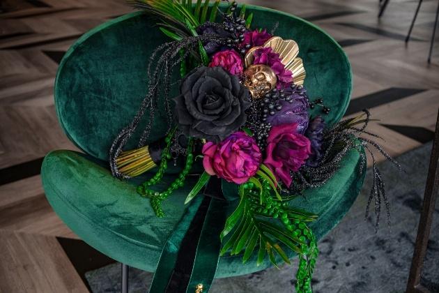 bridal bouqet on green velvet chair