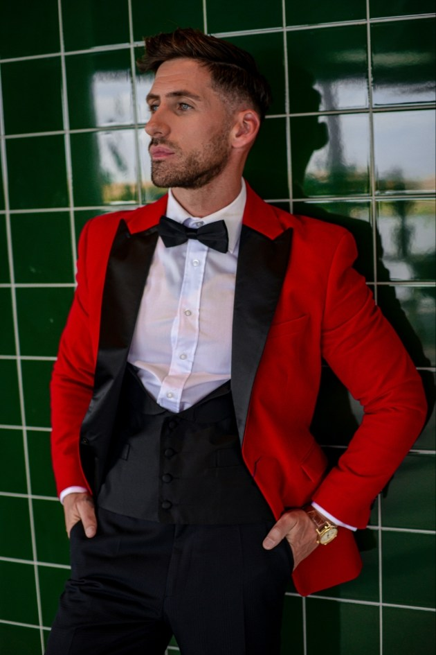groom wearing a red dinner jacket with black lapels