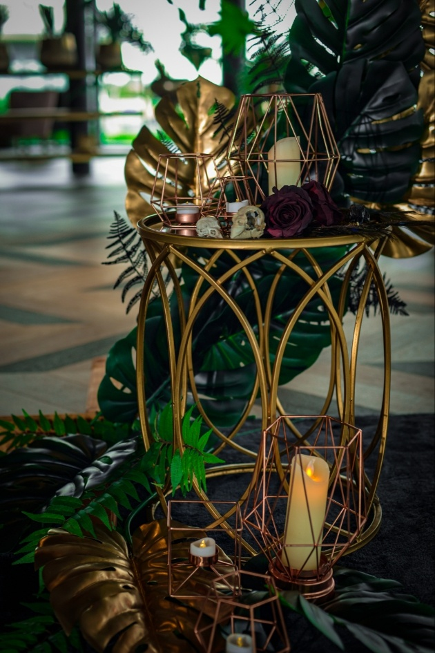 venue styling props including gold candle cages