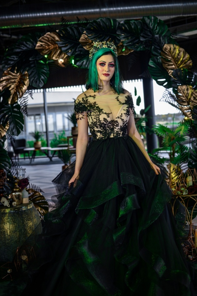 bride with green hair wearing black lace wedding dress