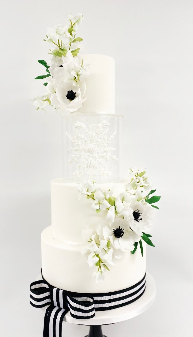 white 4 tier black and white cake with invisible layer