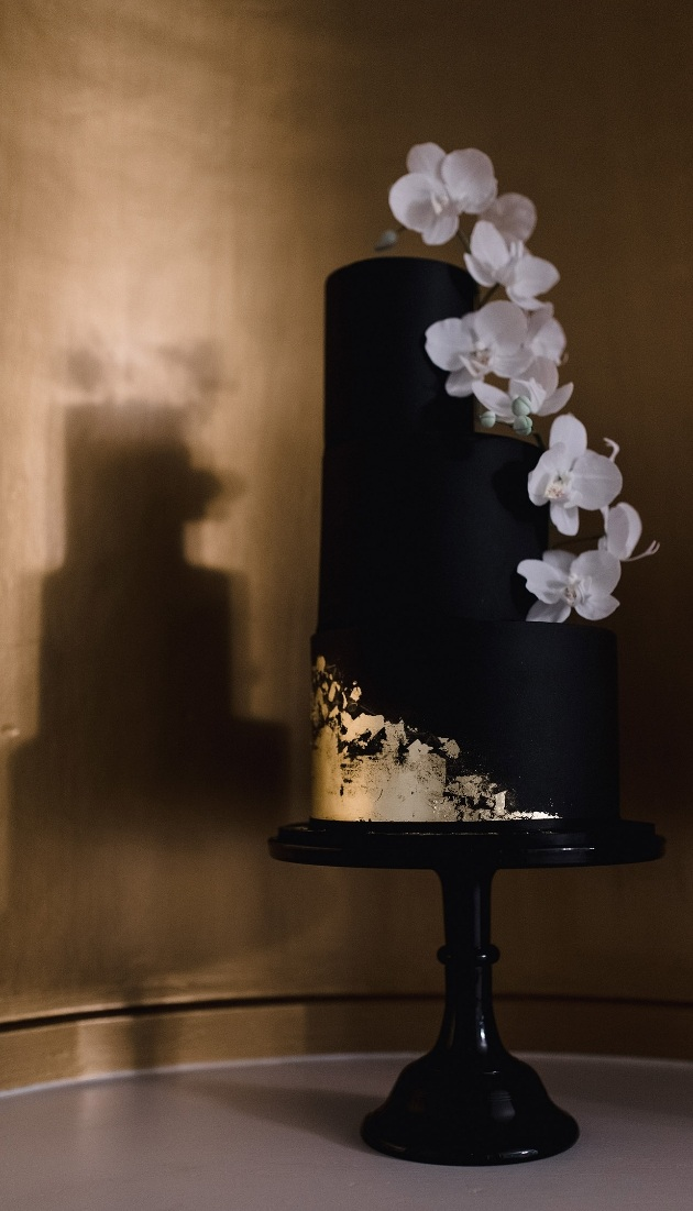 Black and gold iced orchid wedding cake