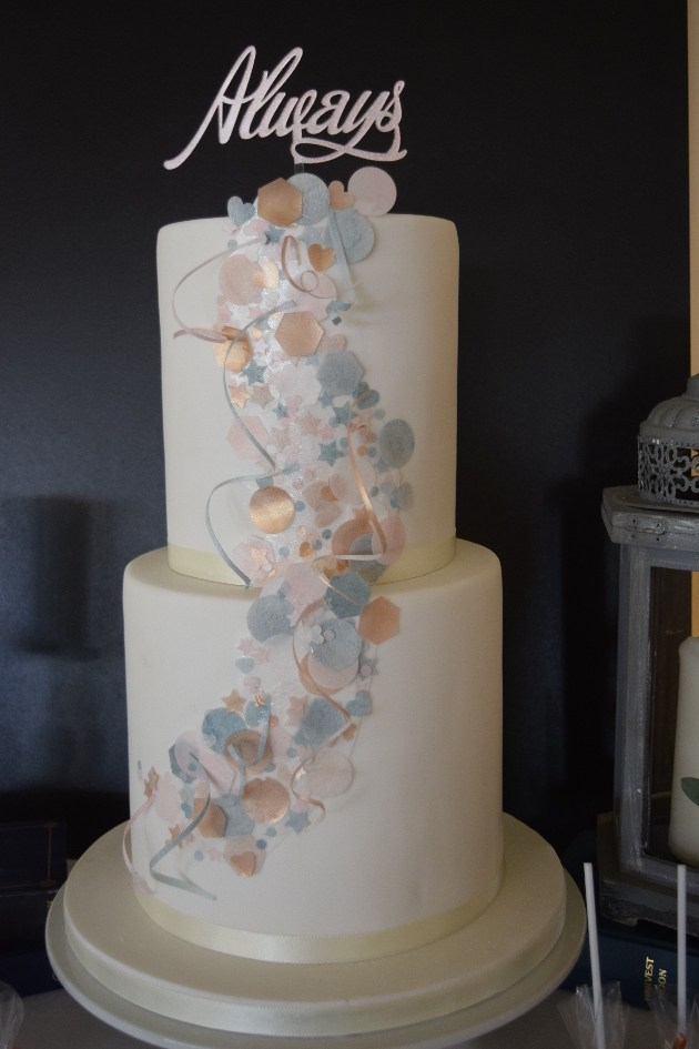 Wedding cake with blue and pink wafer paper decoration and Always topper