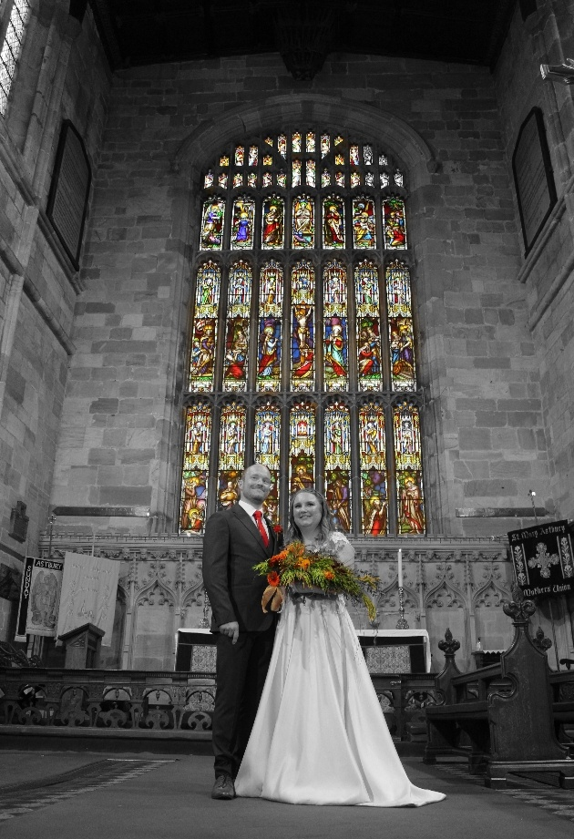 colour spot image of bride and groom in church