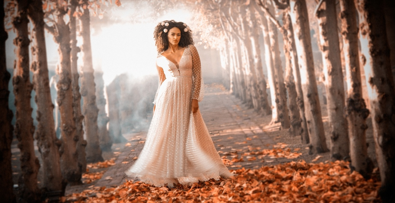 Autumnal shot of bride in the woods