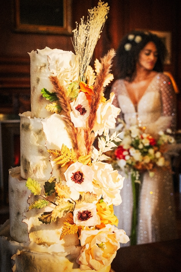 wedding cake with bride in the background