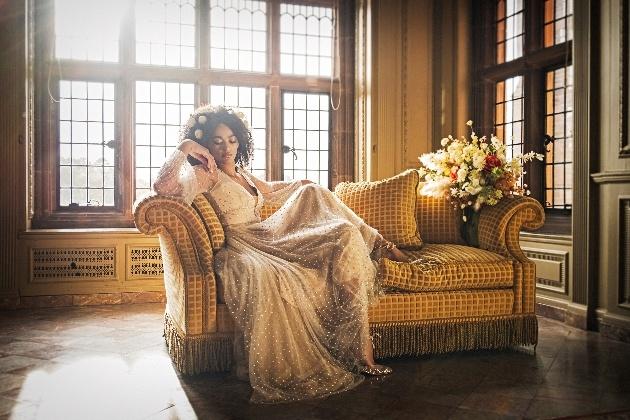 bride reclining on sofa at thornton manor