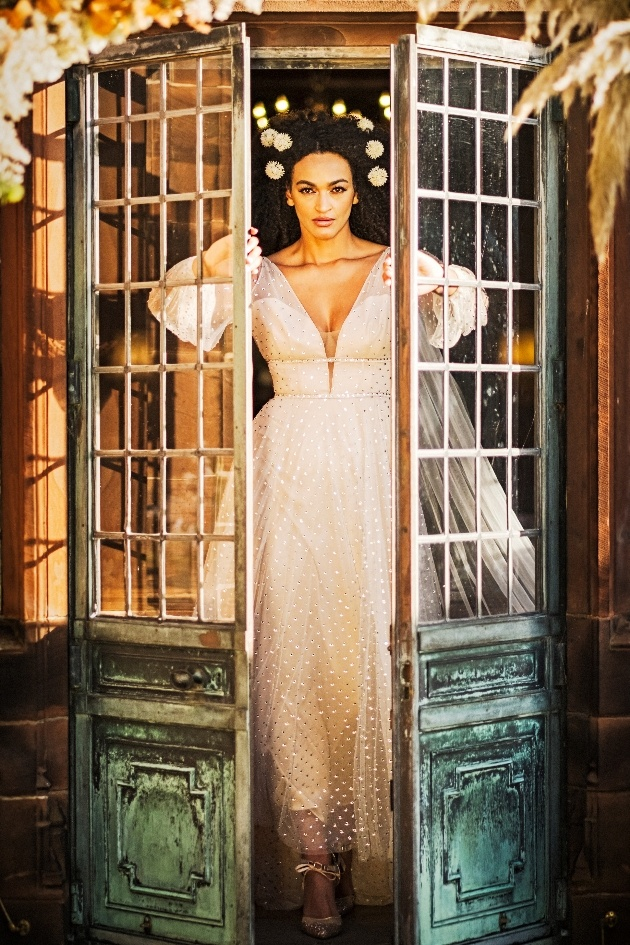 bride makes her entrance through french doors.