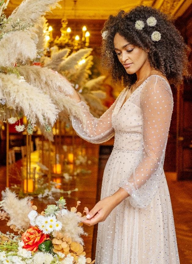 bride admires centrepieces