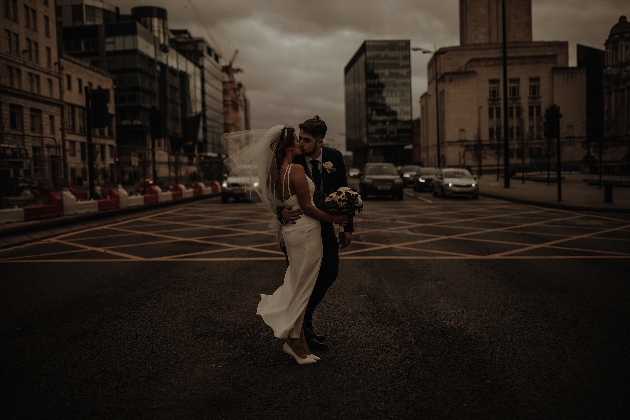 Couple kiss in road