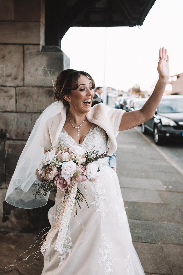 Happy bride waving