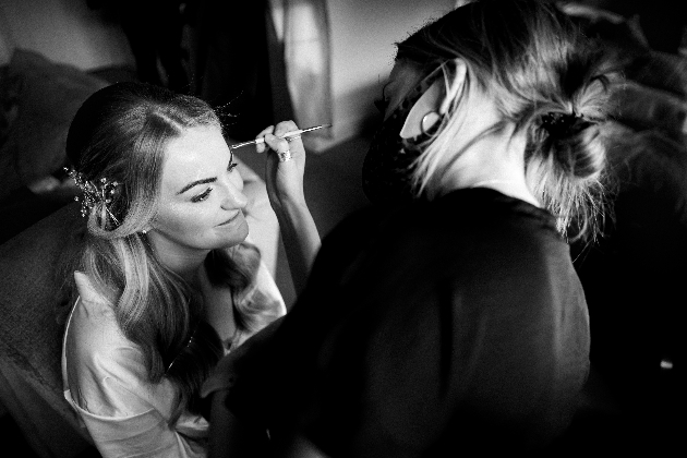 Black and white images of Leah doing a bride's makeup