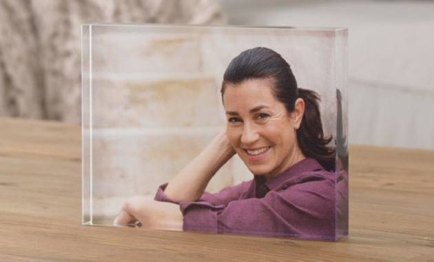 clear perspex block with a photo of a woman in it