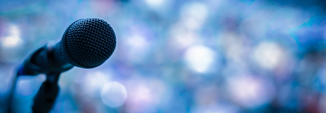 microphone with blue lights in the background